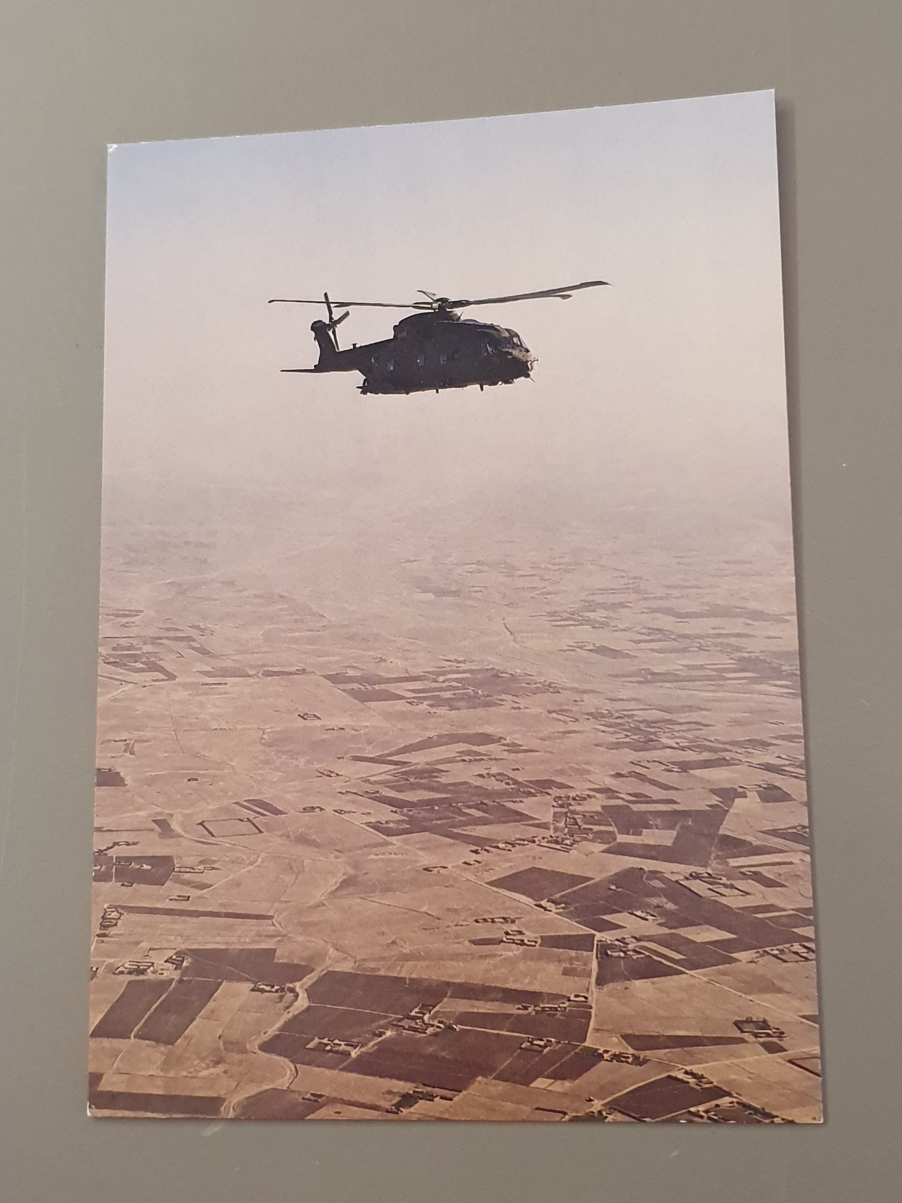 Helicopter flying over Helmand, Afghanistan postcard